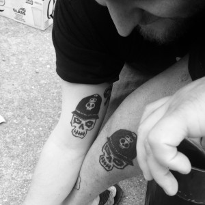 Zach Clark and Zach Cousins showing off their matching tattoos Saturday at Brashland